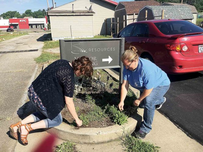 Heather Ayers, left, and Treasa Mackey, right, both from Consumer Credit Counseling Service. They are completing a landscaping project at SW Resources as part of the United Way's 2017 Day of Action. (Photo Provided)