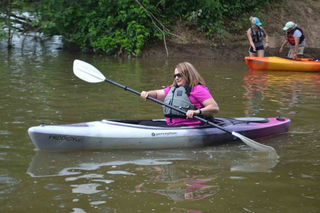 Karen Foster, 48, of Parkersburg, paddles her way along the Muskingum River during the Kayaking 101 class on Wednesday. (Photo by Peyton Neely)