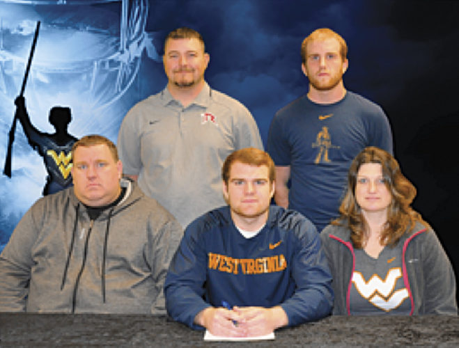 Roane County's Tyler May signed as a preferred walk-on for the West Virginia University football program earlier this year. Pictured in the front row from left to right: father Greg May, Tyler, mother Penny May; back row (L to R): Roane County head coach Paul Burdette and May's brother Cody.