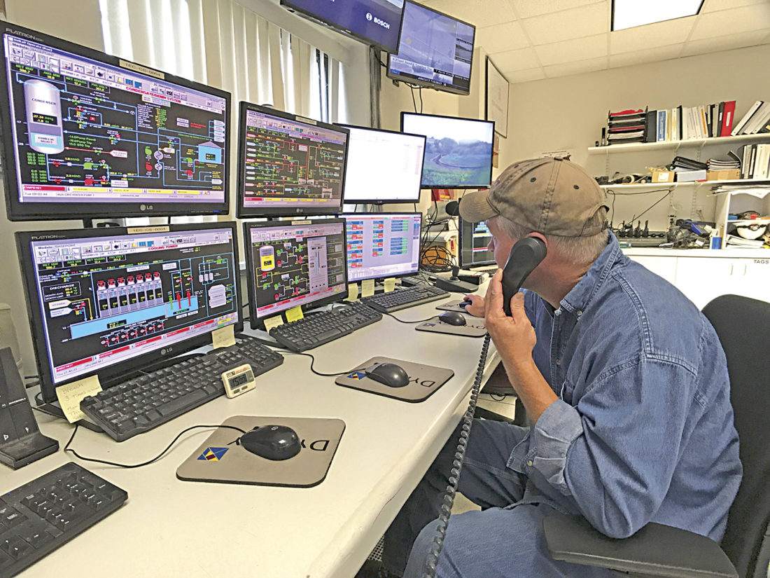 Photo by Janelle Patterson Control Room Operator Steven Anderson takes a call from contractors working on maintenance within the Dynegy energy plant in Beverly Friday.
