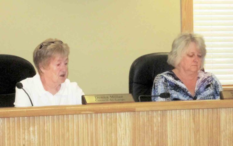 Belpre City Councilmembers Donna Miller, left, and Susan Abdella talk during Monday's meeting of Belpre City Council. (Photo by Wayne Towner)