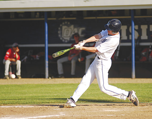 Marietta Post 64's Brandon Neville grounds to second base during an American Legion baseball game against Athens Post 21 Tuesday at Don Schaly Stadium in Marietta. Post 64 won, 13-12. Photo by Jordan Holland.
