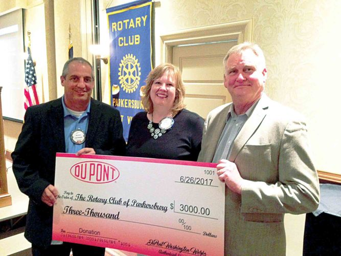 Photo Provided Jay Valvo, plant manager at the DuPont Washington Works, presents a check for $3,000 to Jill Parsons and Robert Newell of the Parkersburg Rotary Club during the club meeting on Monday.