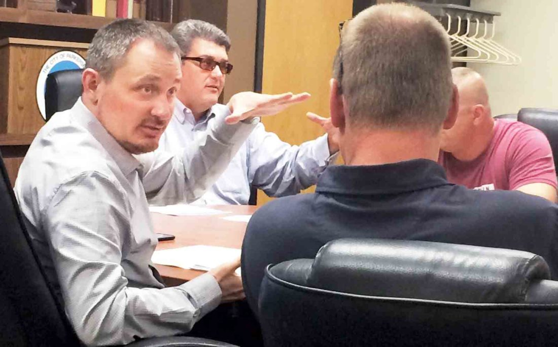 Parkersburg Mayor Tom Joyce and Parkersburg City Finance Director Eric Jiles discuss options in closing the city pension plan with members of the pension boards for the Parkersburg Police and Fire Departments. (Photo by Brett Dunlap)