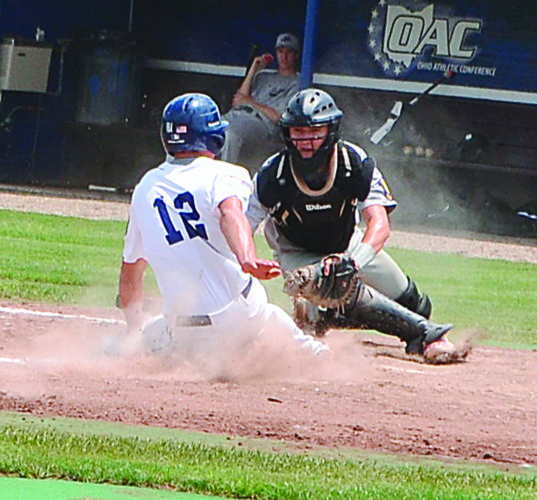 Marietta Post 64's Isaac Huffman slides safely into home plate as Lancaster catcher Logan Fyffe attempts to apply the tag during an American Legion baseball game against Lancaster Saturday at Don Schaly Stadium.  Photo by Mike Morrison