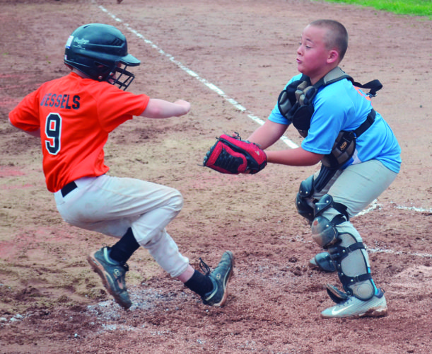 Photo by Ron Johnston Marietta's Eli Vessels, left, is tagged out at the plate by Worthington Wildcats catcher Charlie Williams during 8U All-Star Tournament baseball action at the Worthington Ball Fields in Parkersburg Saturday.