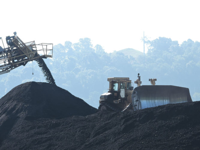 Photo by Casey Junkins  An operator moves coal at a Murray Energy Corp. operation. A new West Virginia University study predicts Mountain State coal production to grow slightly this year before eventually falling.