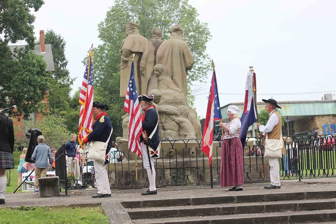 Photo by Janelle Patterson Members of the Marietta chapters of the Daughters and Sons of the American Revolution retire the colors after the 230th Anniversary Celebration of the Northwest Ordinance of 1787 in Marietta Thursday.