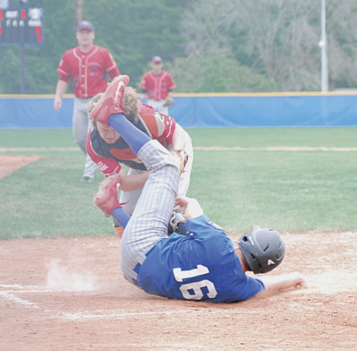 Beverly/Lowell Post 389/750's Logan Isner (16) is tagged out at home by Tuscarawas County Post 205 catcher Paul Thomas during the bottom of the sixth inning of an American Legion baseball game Saturday at Don Coss Field in Cambridge, Ohio. Beverly/Lowell won, 6-2. Photo by Jordan Holland.