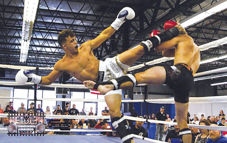 Parkersburg's Ray Davila, left, pictured here landing a kick against Daniel Hague during an amateur bout last month in Moundsville, is competing in the 2017 International Kickboxing Federation World Classic, which starts Friday in Orlando, Fla. Photo courtesy of Shawn Eisler.