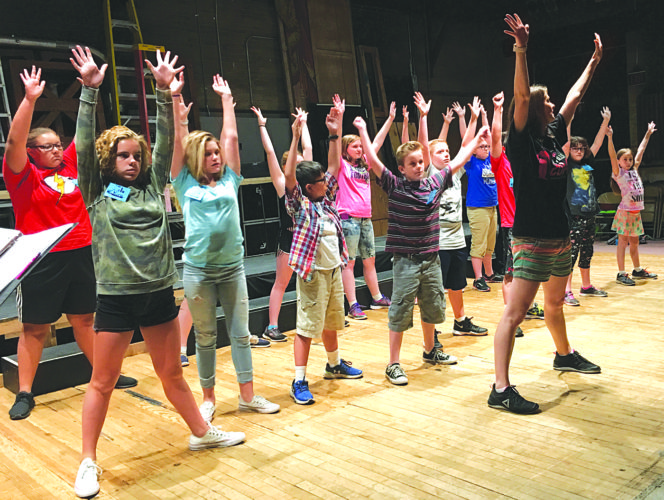 Photo by Michael Erb Instructor Alison Cressey, right, leads a group of students in a song and dance routine Friday at the Smoot Theatre's annual Camp Vaudeville. The students will perform an original musical at 7 p.m. Tuesday at the Smoot.