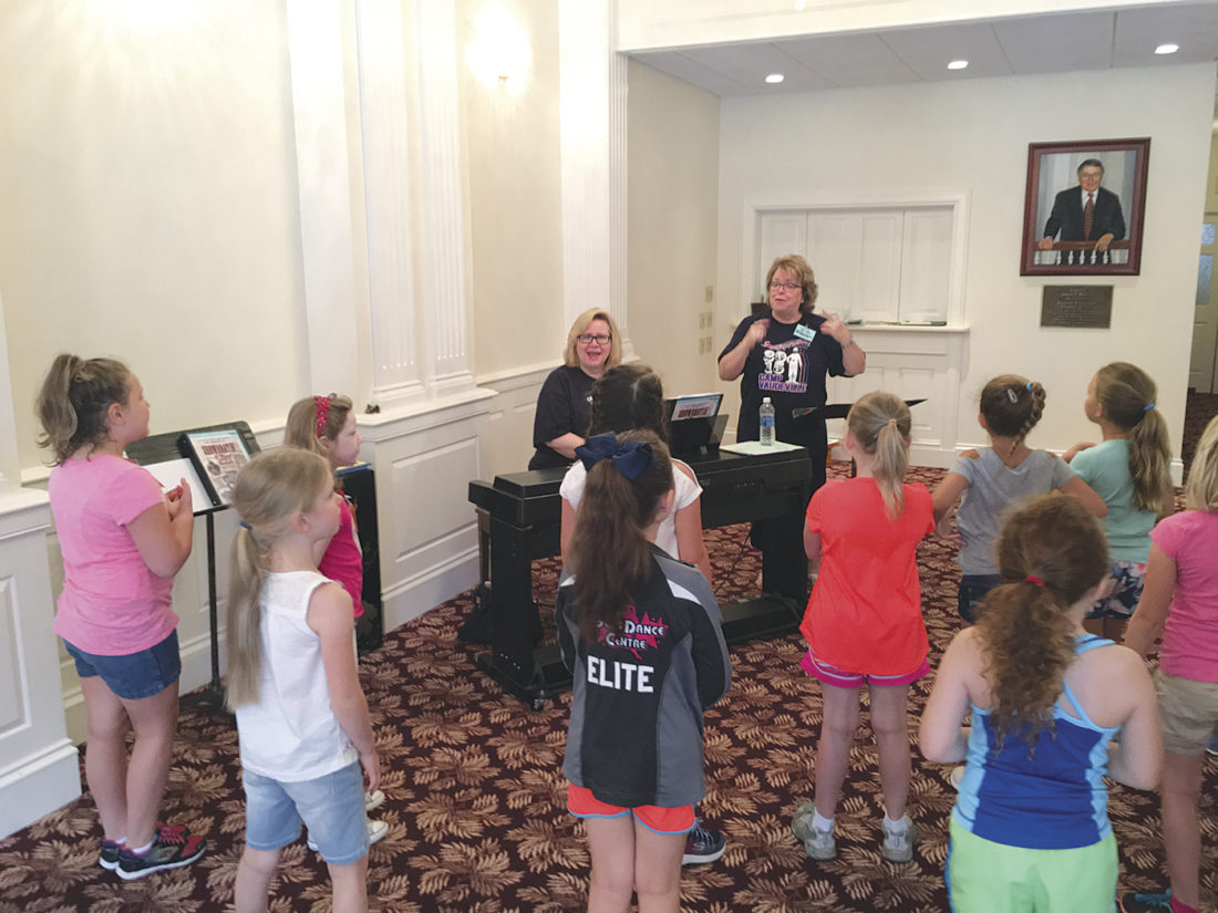 Photo by Michael Erb Marsha Parsons plays piano while Barbara Full leads a group of second- and third-graders in a musical number Friday at Camp Vaudeville at the Smoot Theatre in downtown Parkersburg. The two retired Wood County Schools teachers were among a dozen professionals teaching students this week about song, dance and the theater.