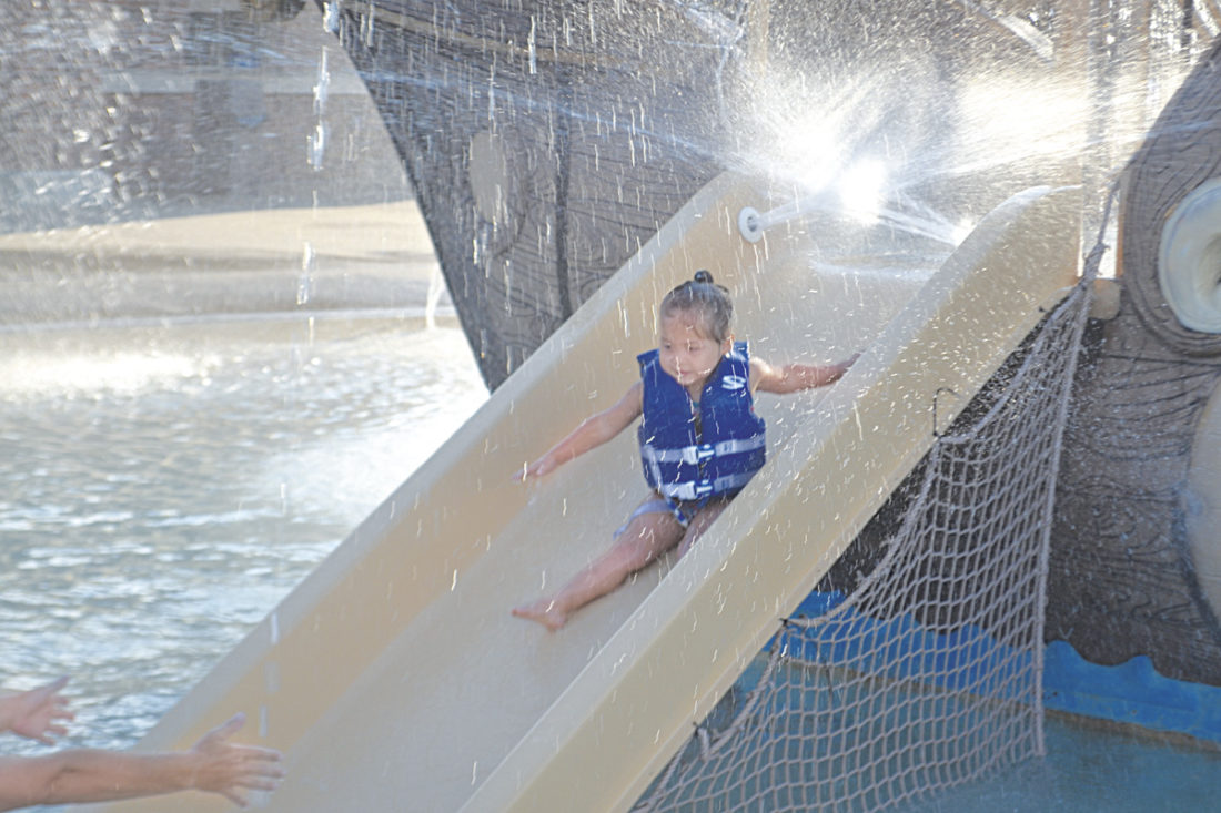 Photo by Peyton Neely Kyleigh Braun, 3, of Marietta, goes down the slide at the Marietta Aquatic Center during the Right Path for Washington County's Family Swim Night on Friday evening.