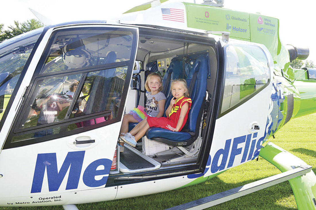 Photo by Doug Loyer Madeline Morganstern, 6, and her sister Sophia Morganstern, 3, both of Hackney, enjoy sitting in the MedFlight helicopter.