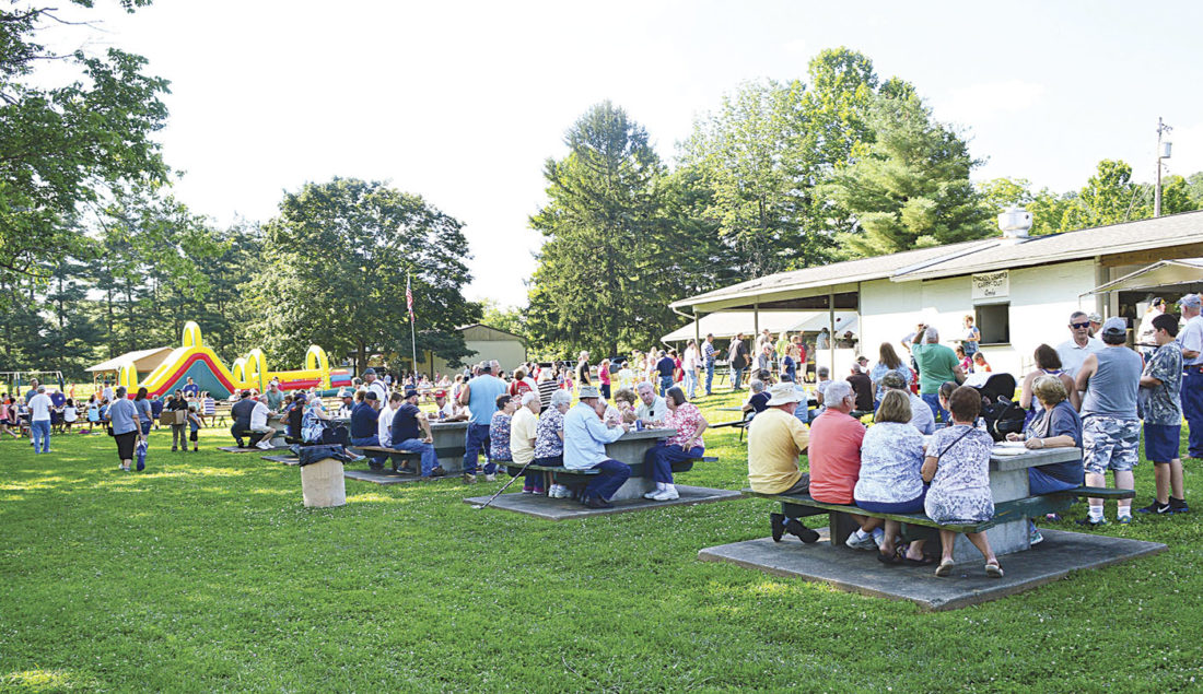 Photo by Doug Loyer There was a large turnout at the Lowell-Adams VFD Ice Cream Social held on Buell Island in Lowell.