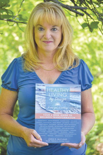 Photo Provided Linda McClead holds a copy of her new book.