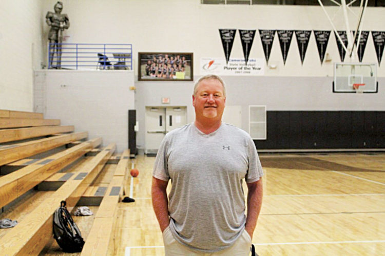 Rick Leach walks inside the Tyler Consolidated High School gynasium. Leach returned home as the new Tyler Consolidated boys basketball coach.  Photo provided