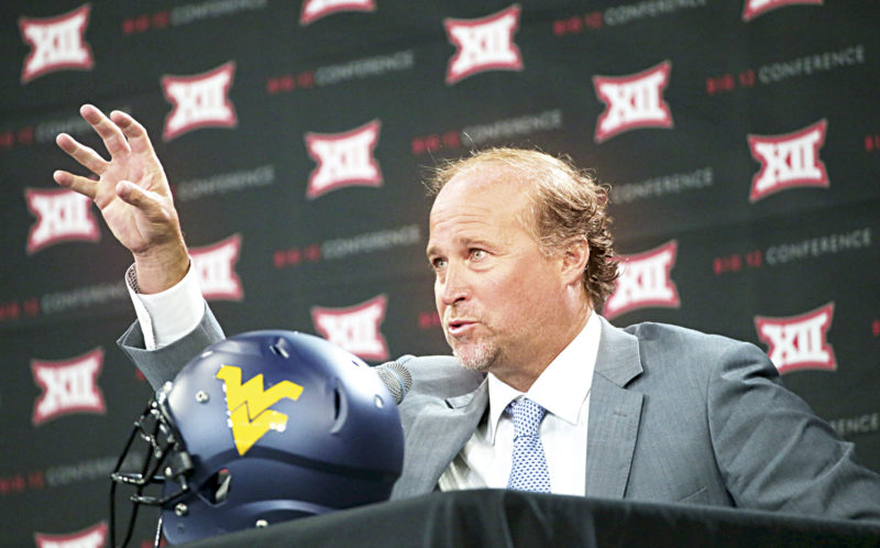 West Virginia head football coach Dana Holgorsen speaks to reporters during the Big 12 NCAA college football media day in Frisco, Texas, Tuesday, July 18, 2017. (AP Photo/LM Otero)