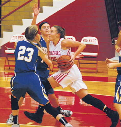 Parkersburg High's Madi Mace works against two Warren defenders to get to the basket during last year's Jack Stephens Memorial Holiday Tournament inside PHS Memorial Fieldhouse. Photo by Jay W. Bennett.