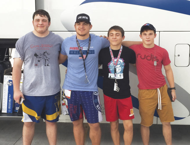 From left, Parkersburg South's Louden Haga, Braxton Amos, Brayden Roberts and Parkersburg High's John Martin Best pose for a picture after earning All-American honors at the U.S. Marine Corps Cadet Nationals. Photo courtesy Anika Amos.