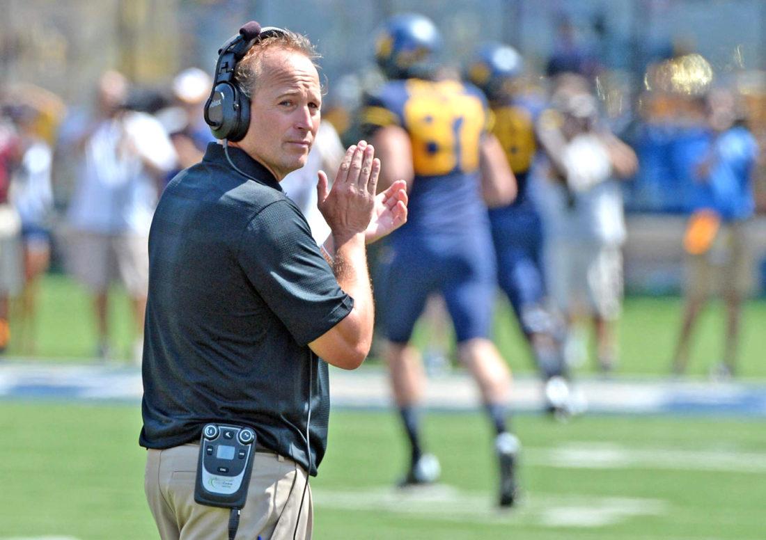 West Virginia head coach Dana Holgorsen surveys the field during a practice last season. Photo courtesy of the Gazette-Mail.