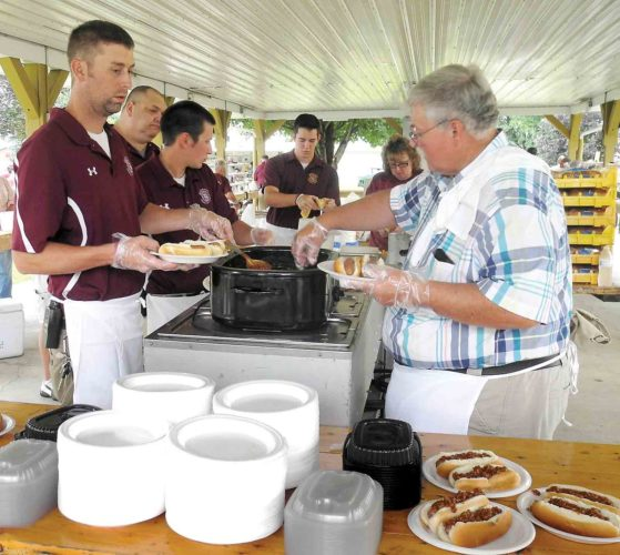 Turning out hot dogs for the 73rd annual Williamstown Volunteer Fire Department's Ice Cream Social were, from left, John Wilson, Moose Johnson, James Dotson, Zac Wilhide, Vera Delancey and Dean Lewis. (Photo by Jeffrey Saulton)