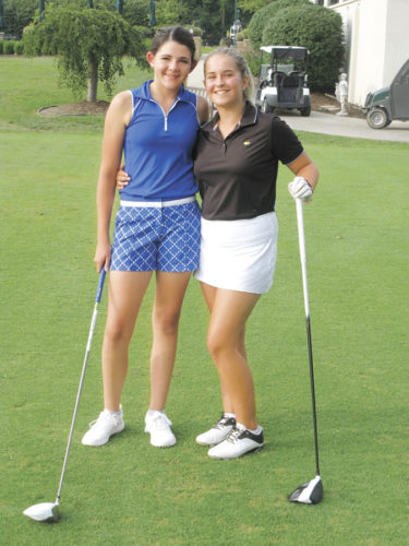 Cousins Molly McLean, left, and Nicole Lincicome pose for a picture at the Parkersburg Country Club. They will be competing in the final event at the PCC on the Callaway Junior Tour when action gets underway at 8:30 a.m. on Monday. Photo by Jay W. Bennett.