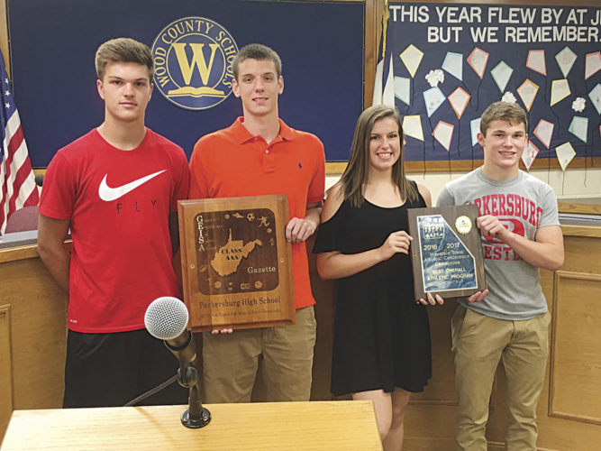 From left, Parkersburg High School's Parker Miller, Kyle Mullen, Emily Williamson and John Martin Best pose for a picture at a recent Wood County Board of Education meeting. The Big Reds not only won the best overall athletic program for the 2016-17 school year in the Mountain State Athletic Conference, but the red and white also picked up the Gazette-Mail Excellence In Sports Award for Class AAA.