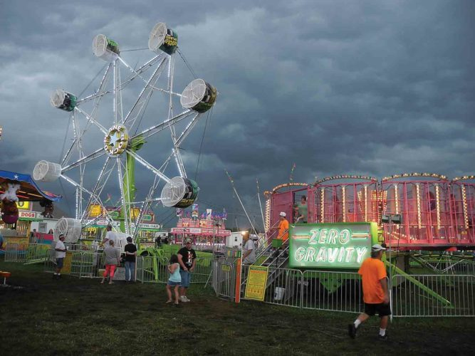 Dark skies and rain forced rides at the carnival at the West Virginia Interstate Fair and Exposition to close around 5:30 p.m. Saturday. (Photo by Jeffrey Saulton)