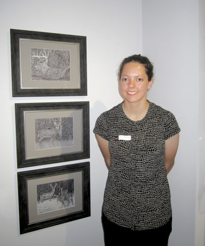 Photo by Wayne Towner Erin McKown, of Ravenswood, shows the three ballpoint pen drawings she entered in the exhibit.