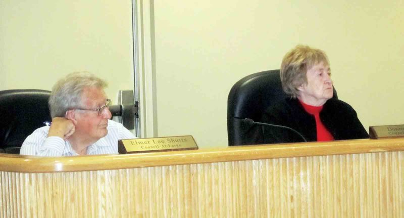 Belpre City Council members Elmer Lee Shutts, left, and Donna Miller, right, listen to reports at Monday's meeting of Belpre City Council. (Photo by Wayne Towner)