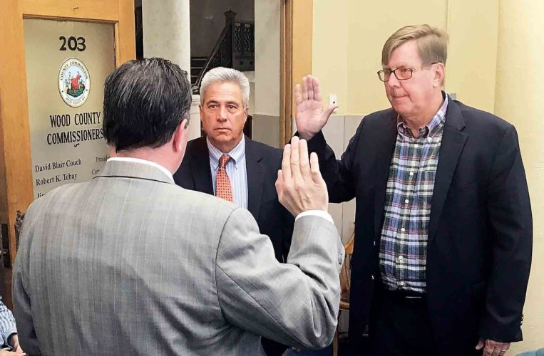 Wood County Building Authority Chairman Steven Shaffer, center, and Vice-Chairman Tim Northrup, right, take the oath of office Monday as administered by Wood County Commission President Blair Couch, left. Cathleen Roedersheimer, not pictured, also was sworn in Monday.  (Photo by Michael Erb)