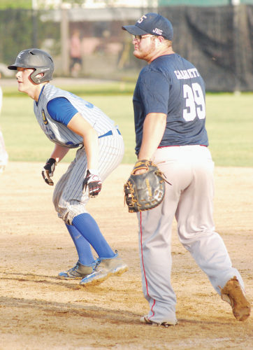 Beverly/Lowell Post 389/750's Logan Isner, left, leads off first base as Parkersburg Post 15's Wade Garrett holds him on during an American Legion baseball game earlier this summer at City Park. Beverly/Lowell plays in the Ohio state tournament today in Lancaster.