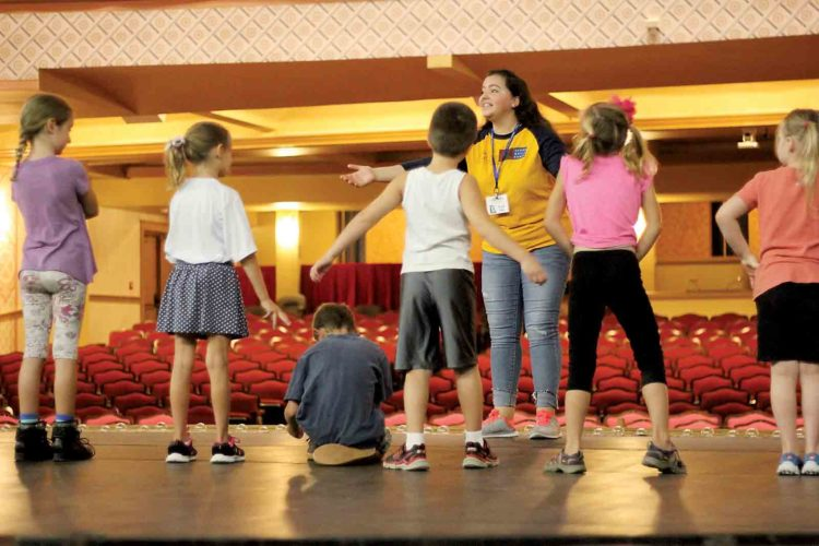 """Photo by Janelle Patterson Tour actor and director Lexi Inks, of Florida, teaches local children their songs Wednesday as they prepare to play pumpkins in Saturday's Missoula Children's Theatre show """"Cinderella"""" at Peoples Bank Theatre."""