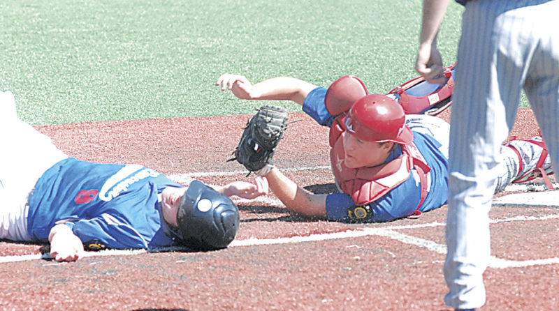 Beverly/Lowell Post 389/750 catcher Logan Isner, right, tags out Lancaster's Tanner Griggs at the plate during an American Legion baseball state tournament game Saturday at Beavers Field in Lancaster, Ohio. Photo by Mike Morrison.