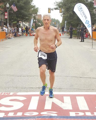 Tom Gyongyosi crosses the finish line at last year's Parkersburg News and Sentinel Half Marathon. Photo by Jeff Baughan.
