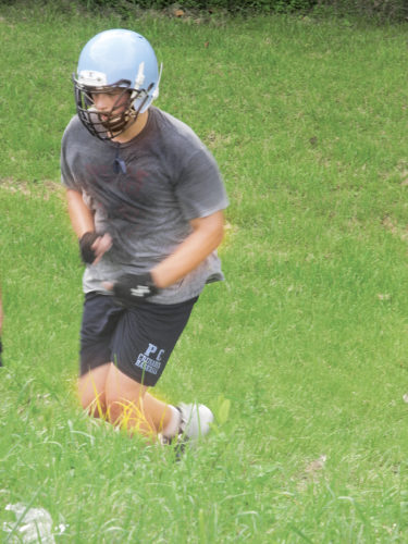 Photo by Steve Hemmelgarn A Parkersburg Catholic player runs a hill during a drill Tuesday at Crusader football practice.