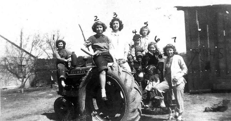 Photo from WCHPS archives Farm tractors aren't for plowing only.  Posing on the Farmall tractor are:1) Garnet Vaughn, 2) Betty Brown, 3) Barbara Russell, 4) Arthur Vaughn, 5) Jean Bailey, 6) Lena Murphy, 7) Wilma Jeffrey, 8) Helen Vaughn, 9) Lynn Vaughn.