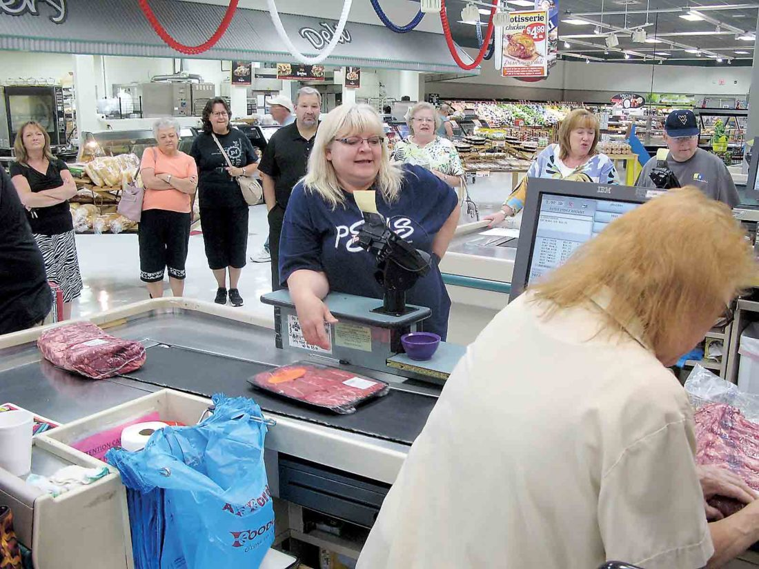 Photo By Jess Mancini Foodland cashier Mae Cottle rings up Patti Rumbaugh's groceries in the Supermarket Sweepstakes sponsored by The Parkersburg News and Sentinel and Foodland.