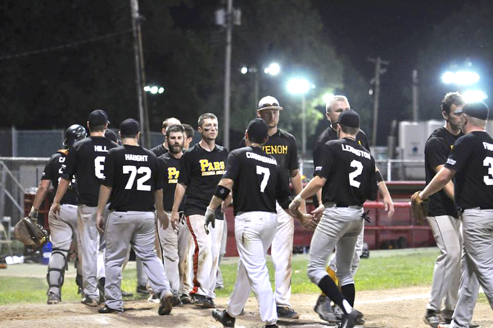 Members of the Misfits adult baseball team shake hands with members of the Venom team, managed by Mike Scottodiluzio, during a game at City Park earlier this season.