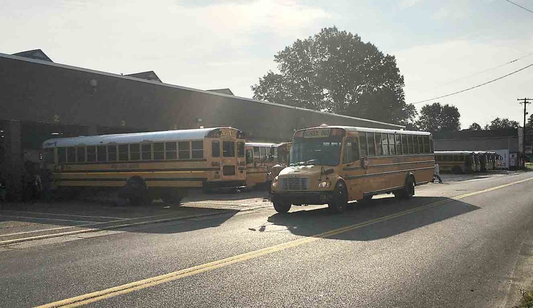 """Photo by Michael Erb Wood County Schools buses start to line up at the district's 19th Street bus garage in Parkersburg Friday, with some leaving to conduct """"dry runs"""" of bus routes throughout the county."""