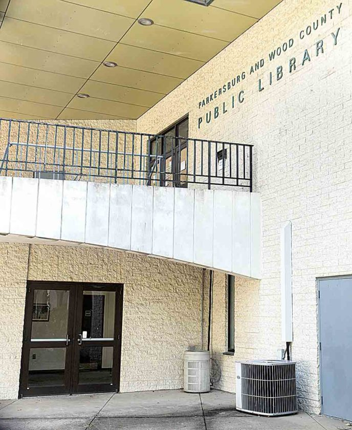 Photo by Jeff Baughan The lower level entrance, used for voting, will become the entrance for the library when the library reopens. The main entrance, top, will remain closed until construction is finished.