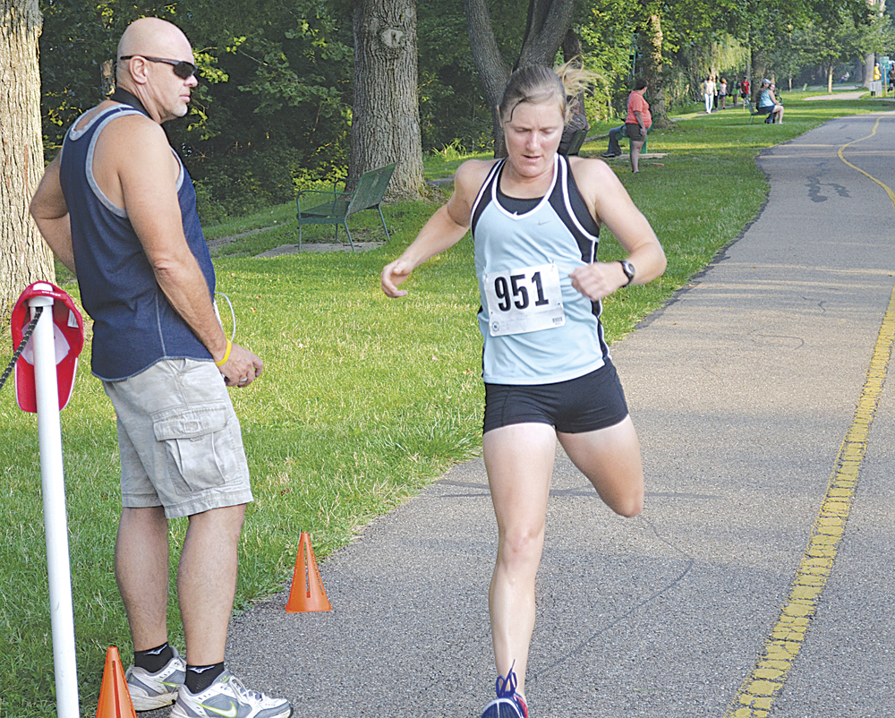 Caitlin Thomas of Marietta College was the first female to cross the finish line in the Marietta Times 5K run Saturday. Photo by Ron Johnston.