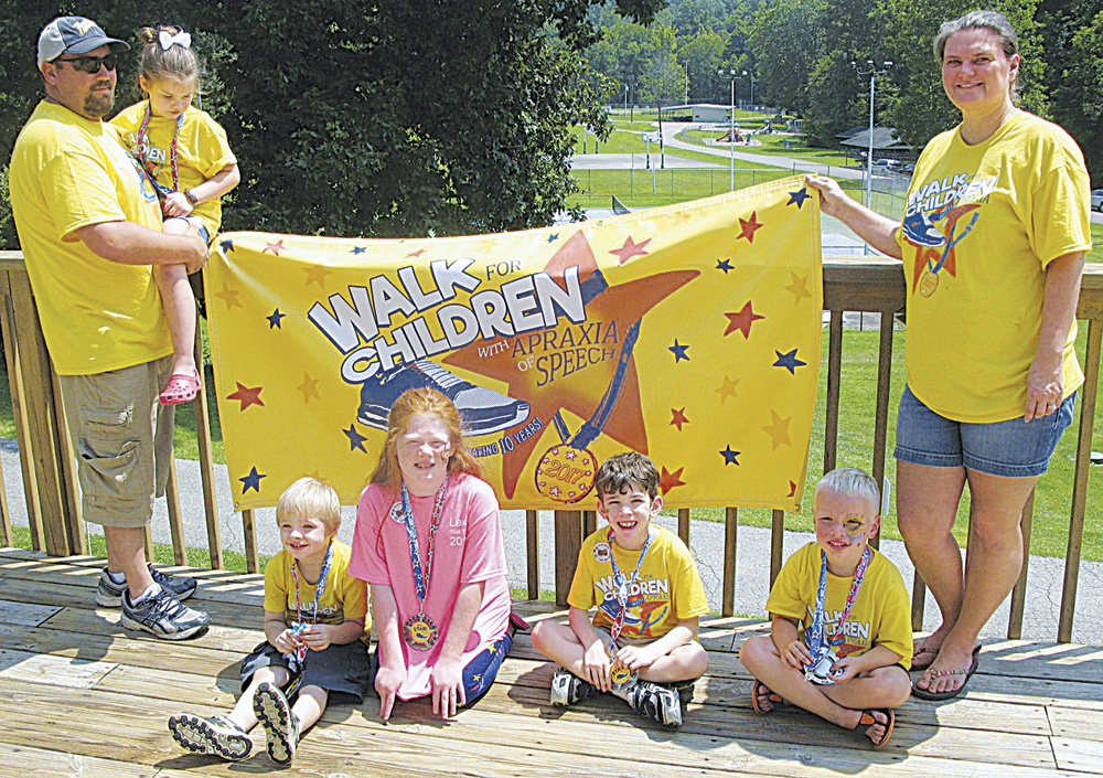 Photo by Jeffrey Saulton Participating in the fourth annual Walk for Children with Apraxia of Speech were, from left, Jody Dowler, Brooklyn Dowler, Gabriel Knight, Lexis Rinehart, Brandtley Miller, Austin Braden and Crystal Wallace.