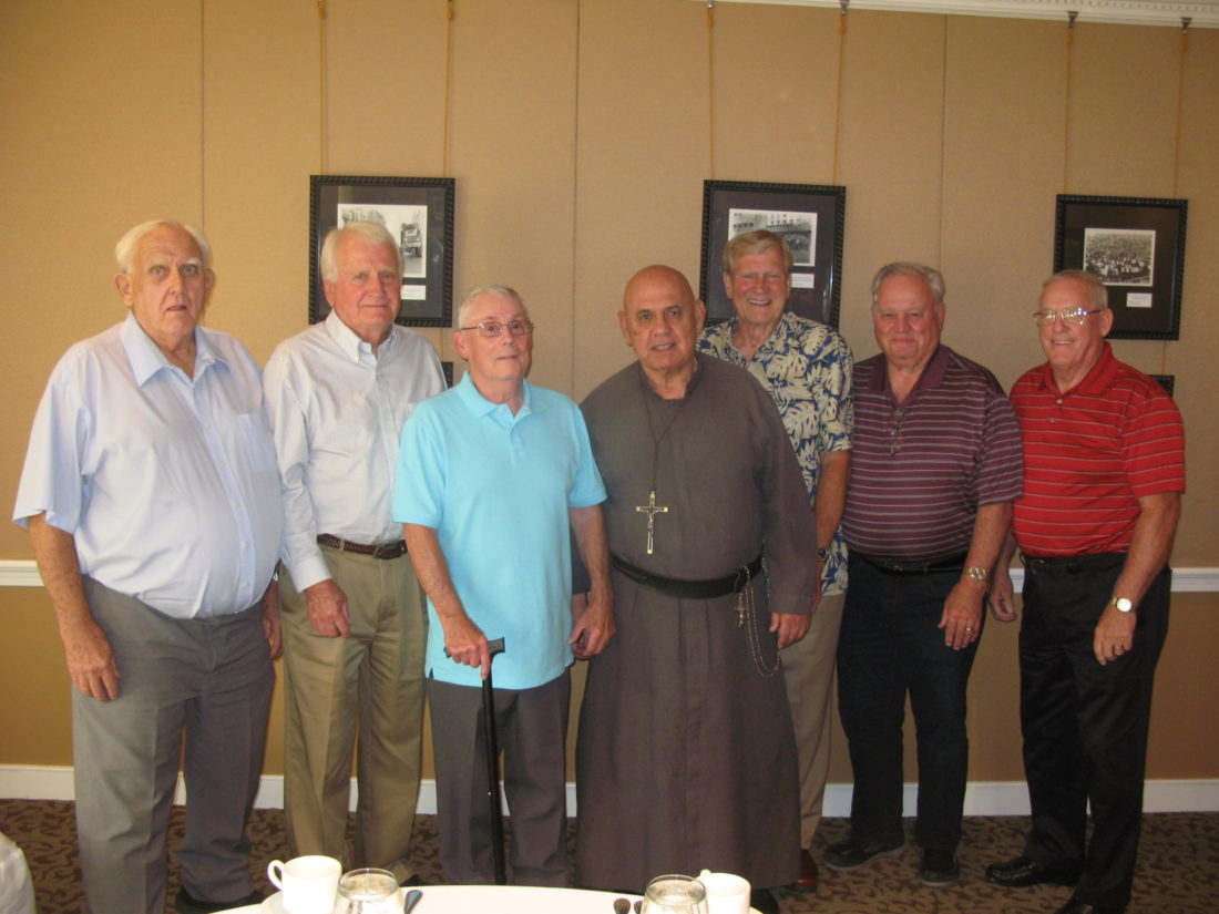 Photo by Paul LaPann  Meeting for dinner recently at the Blennerhassett Hotel are former Parkersburg High School football players, from left, Larry Allen, Mike Dyer, Roger Stoops, the Rev. George Nedeff, Dick McCoy, Larry Holman and Mike Hayden.