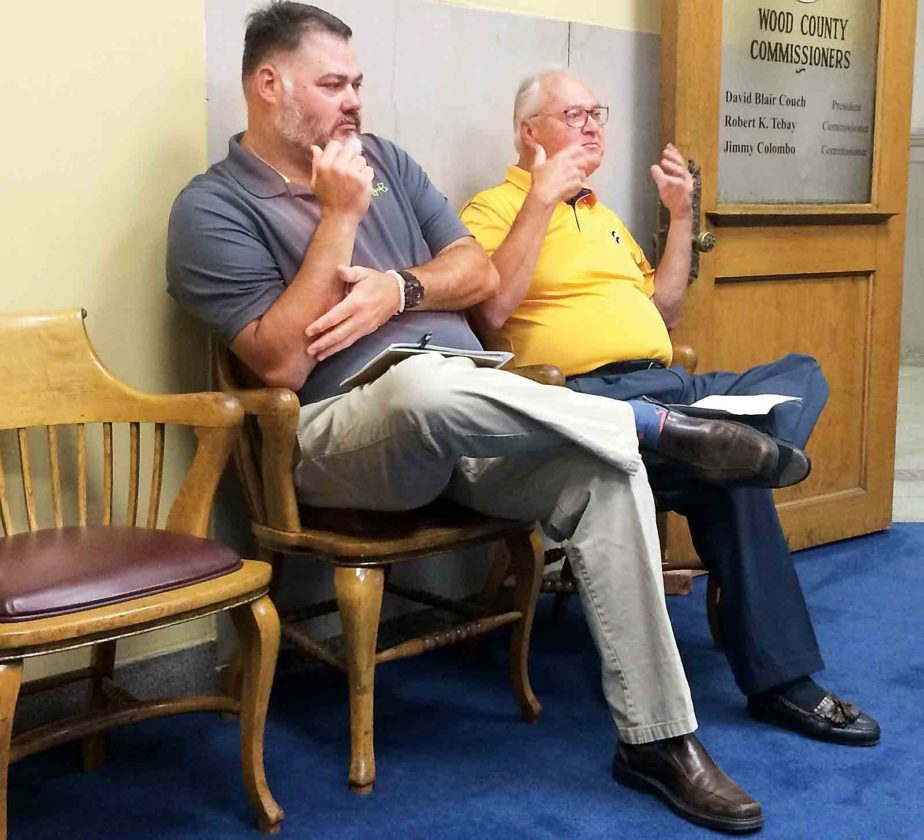 Tom Curry and Keith Curry of Records Imaging & Storage (RIS) in Parkersburg discuss the county's record storage concerns at the old Wood County Sheriff's Department building on Second Street at Monday's county commission meeting. (Photo by Brett Dunlap)