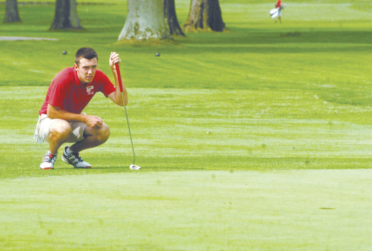 Parkersburg's Trey Rossana lines up a putt during his round Monday at the Callaway Junior Tour's Parkersburg Country Club High School Invitational in Vienna. Photo by Joe Albright.