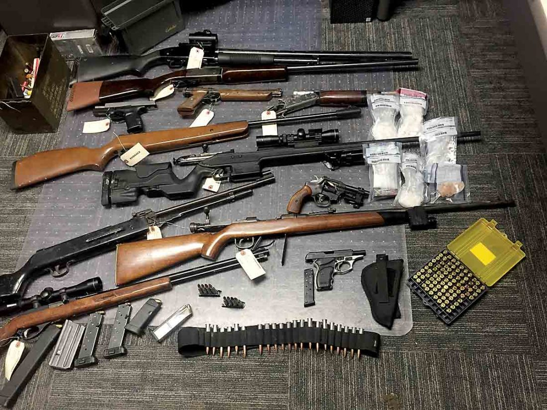 Fourteen guns, multiple knives and more than 12 ounces of methamphetamine were seized during the execution of a search warrant on Aug. 7 in Millfield, Ohio. (Photo provided by the Athens County Prosecutor's Office)