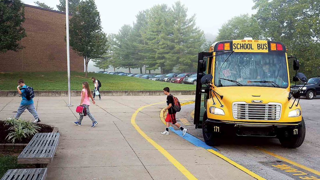 Photo by Michael Erb Blennerhassett Middle School students step off a Wood County school bus Wednesday morning for the first day of school.