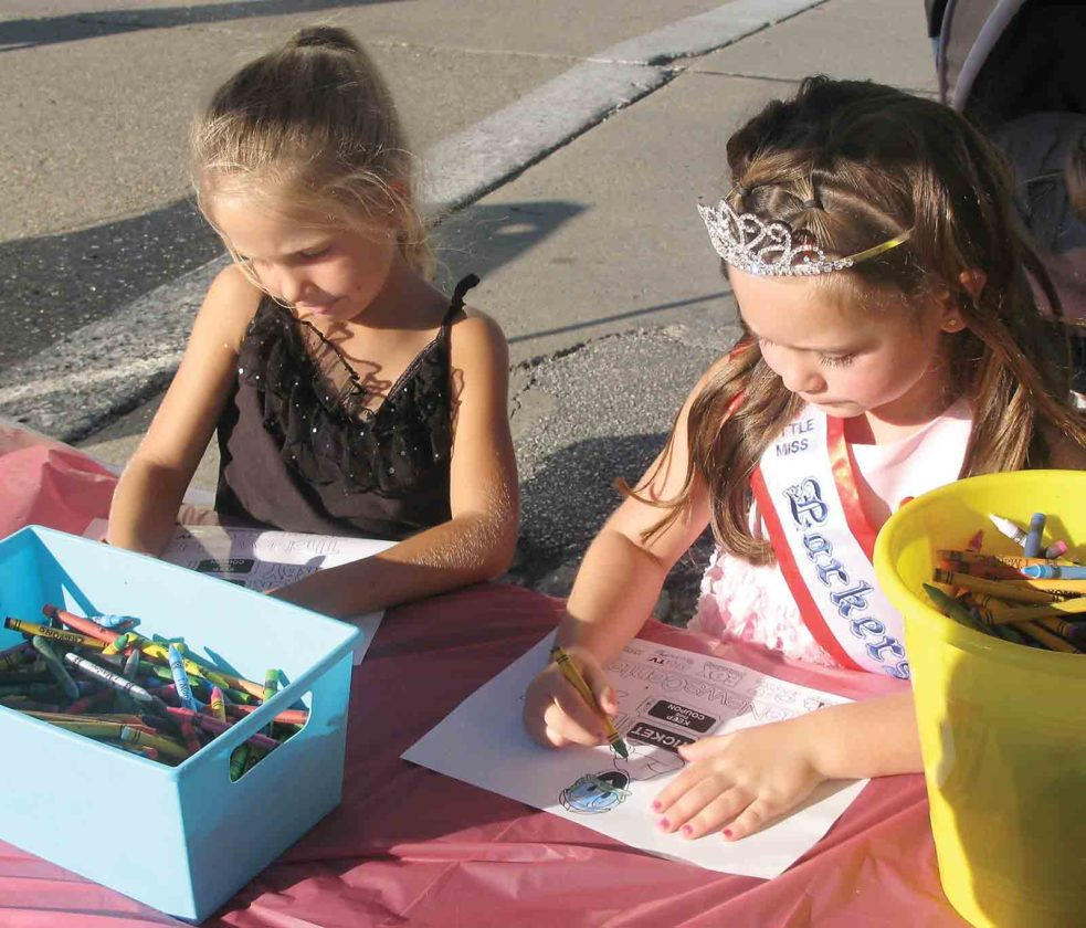 Photo by Jeffrey Saulton Lakotah Mae Prive, left, and Madeline Keller, right, both of Parkersburg, work on entries for the coloring contest.